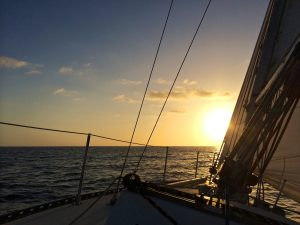 Sunset on the Pacific Ocean just outside of Newport Beach harbor from the sailing vessel Cuajota a Schock Santana 30.